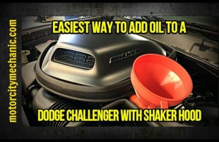 Easiest way to add oil to a Dodge Challenger with Shaker hood For Longville 56655 MN